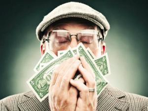 man_smelling_money